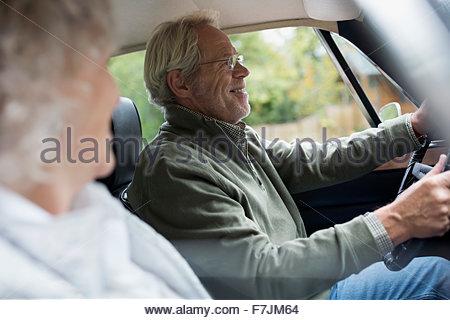 Senior couple driving in car - Stock Photo