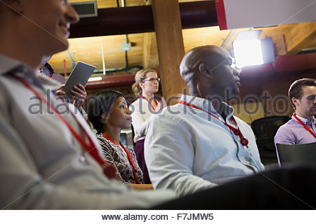 Business people in conference audience - Stock Photo