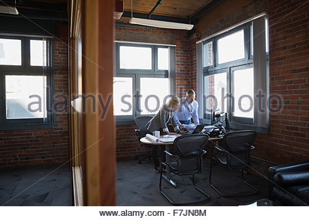 Business people working at office desk - Stock Photo