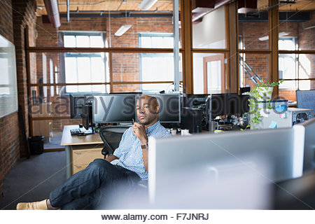 Pensive businessman in office - Stock Photo