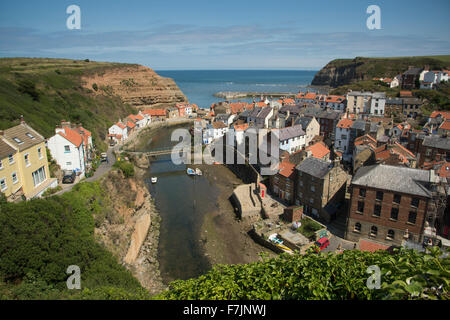 Sunny, high view over picturesque Staithes, North Yorkshire, GB, UK - quaint seaside village with huddled cottages, - Stock Photo