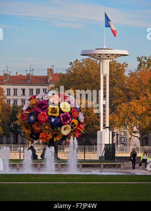 Lyon France Flower bouquet statue and Olympic tower - Stock Photo