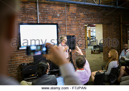 Businesswoman leading conference presentation - Stock Photo