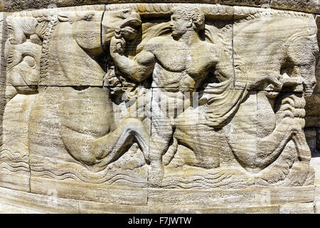 Mythological relief in the Sprudelhof of Bad Nauheim, Germany - Stock Photo