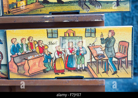 Beehive panels, Slovenia. Copies of originals are a souvenir item with visitors. Originally, the panels decorated - Stock Photo