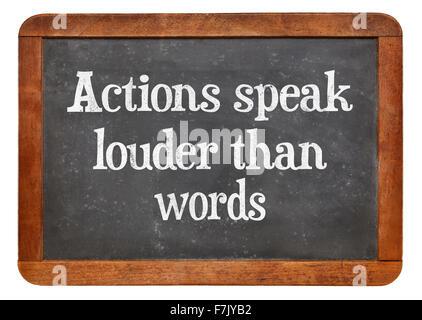 Actions speak louder than words proverb - motivational phrase on a vintage slate blackboard - Stock Photo
