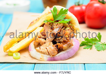 Traditiona Greek Pita Gyros With Meat Fried Potatoes Tomato Onion And Drink On