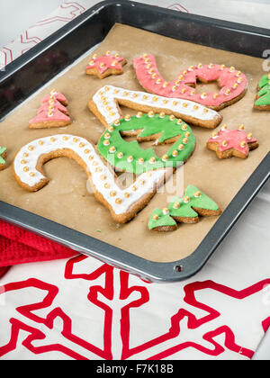 Home-made gingerbread cookies in shape of 2016 New Year digits on baking tray - Stock Photo