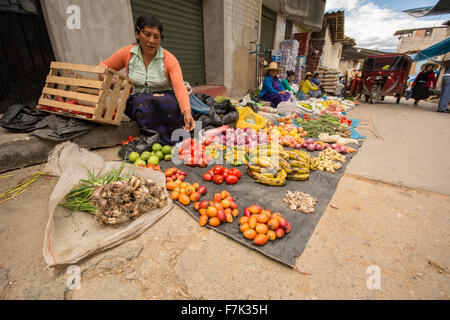 Peruvian woman selling fruit and vegetables on the street in the town of Cajabamba in Cajamarca region of Peru - Stock Photo