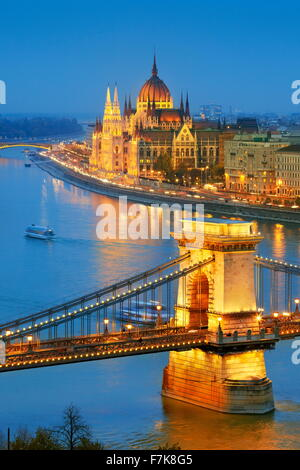 Hungarian Parliament - View at Chain Bridge and The Parliament Building, Danube River, Budapest, Hungary - Stock Photo