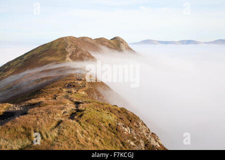 Causey Pike above mist from Scar Crags - Stock Photo