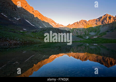 Mountains reflected on pond near Clear Lake, San Juan National Forest, Colorado USA - Stock Photo