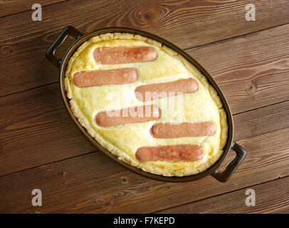 Toad in the hole -  traditional British dish consisting of sausages in Yorkshire pudding batter - Stock Photo