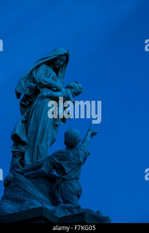 The statue Notre-Dame des naufragés at the Pointe du Raz at night, Plogoff, Finistère, Brittany, France - Stock Photo