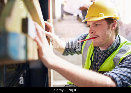 Construction worker using level tool - Stock Photo