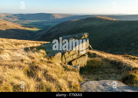 Evening sunlight on Kinder Scout and Crowden Clough, Derbyshire, England, UK with the Vale of Edale in the distance - Stock Photo