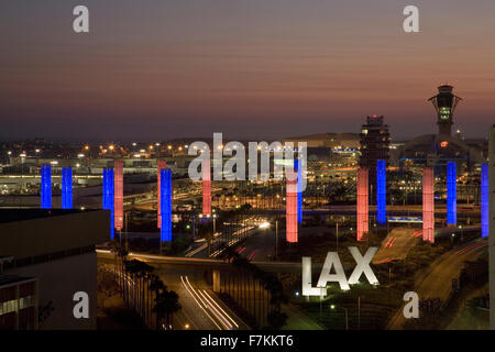 Aerial view of LAX Los Angeles International Airport at sunset with decorative light tubes, Los Angeles, California - Stock Photo