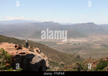 A tourist looking down on the Great Karoo town of Graaff-Reinet from Camdeboo National Park - Stock Photo