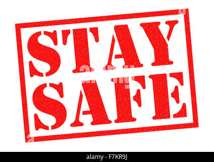 STAY SAFE red Rubber Stamp over a white background. - Stock Photo