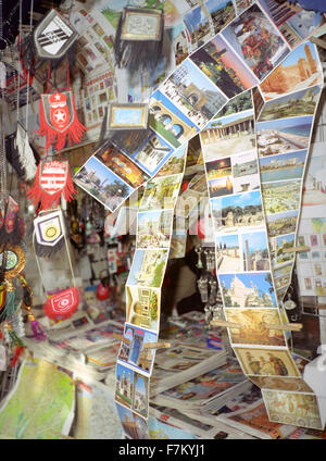 Tourist postcards blow in the wind at a newspaper stand in Tunis, Tunisia, North Africa - Stock Photo