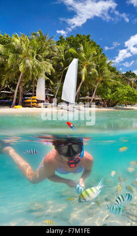 Tropical underwater sea view at snorkeling girl, Ko Samet Island, Thailand, Asia - Stock Photo