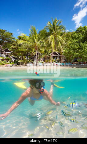 Underwater sea view of snorkeling woman with fish, Ko Samet Island, Thailand, Asia - Stock Photo