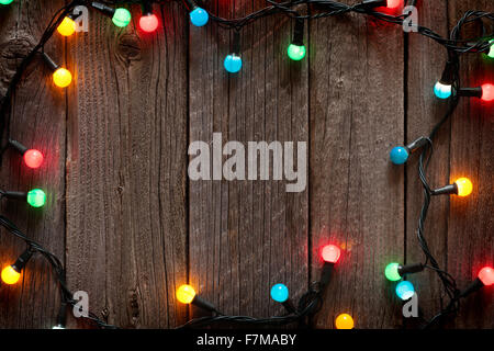 christmas colorful lights frame on wooden table with copy space stock photo