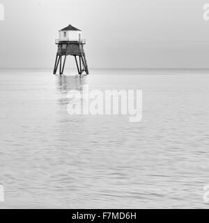 Dovercourt restored Lighthouse at Dovercourt, near Harwich, Essex at high tide, during the Winter solstice. - Stock Photo