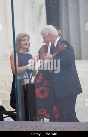 Former US president Bill Clinton hugs First Lady Michelle Obama as Caroline Kennedy claps during the Let Freedom - Stock Photo