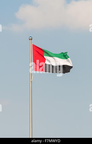 Flag of the United Arab Emirates flying from a pole - Stock Photo