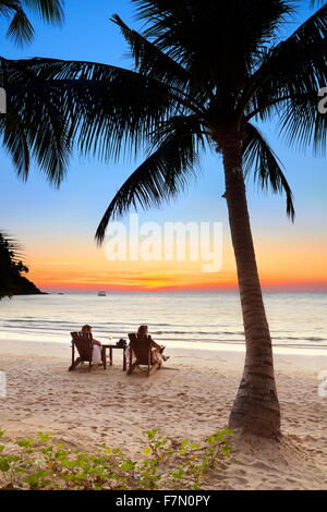 Tourist at the tropical beach after sunset, Koh Samet Island, Thailand - Stock Photo