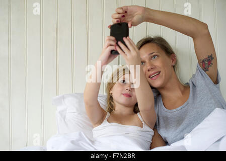 Mother and daughter posing for selfie Stock Photo