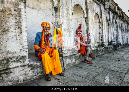 Wandering  Shaiva sadhus (holy men) with traditional body painting in ancient Pashupatinath Temple - Stock Photo