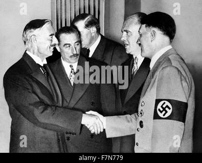 Adolf Hitler greets British Prime Minister Neville chamberlain at Munich 1938 - Stock Photo