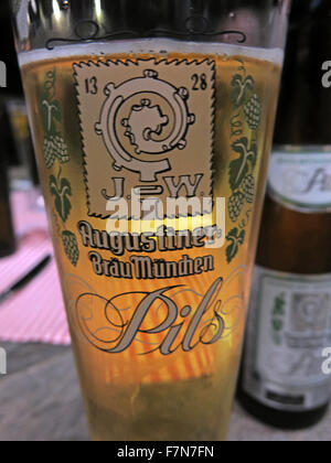 Oktoberfest in Munich,Baveria,Germany,Augustiner Brau,Pils,beer glass - Stock Photo