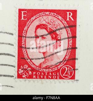 Queen Elizabeth II as she appeared on an  english postage stamp circa 1958. - Stock Photo