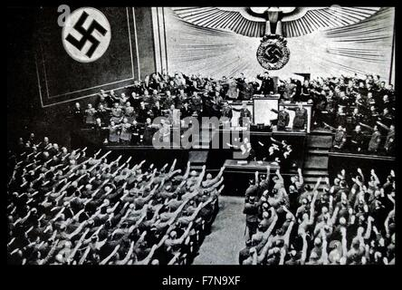 Photograph of a Reichstag Rally from the Kroll Opera House, in Berlin. Hitler addresses the Reichstag putting forward - Stock Photo
