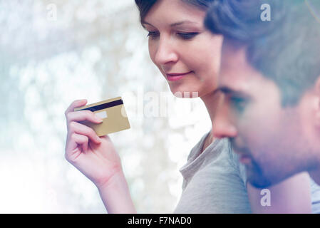 Couple making purchase with credit card - Stock Photo
