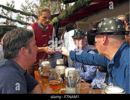 Paying for beer at Oktoberfest,Munich,Bavaria,Germany - Stock Photo