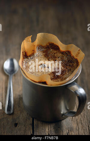 Ground coffee in cup and filter holder - Stock Photo