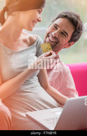 Couple enjoying convenience of online shopping - Stock Photo