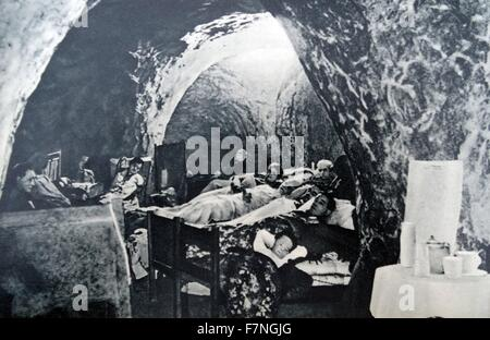 People shelter in underground caverns around London during World War Two air raids 1941 - Stock Photo
