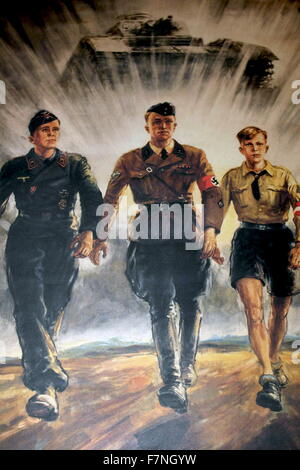 Second world war propaganda poster depicting Nazi soldiers walking in front of a tank. Dated 1941 - Stock Photo