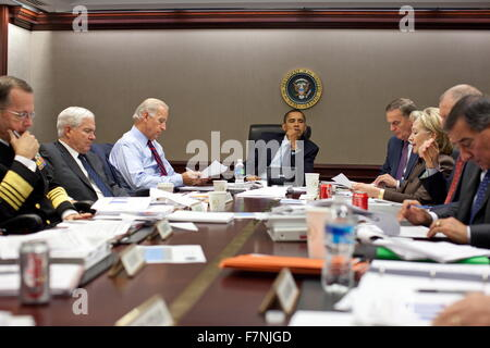 US president Obama has a meeting in 2011 in the situation Room at the White House. To the president's left are: - Stock Photo
