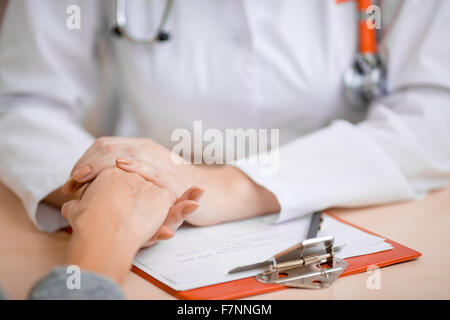 Doctor consoling or supporting patient - Stock Photo