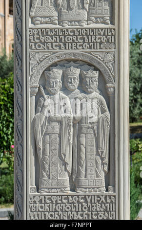 Carved pillar next to Holy Trinity Cathedral of Tbilisi commonly known as Sameba in Tbilisi, capital of Georgia - Stock Photo