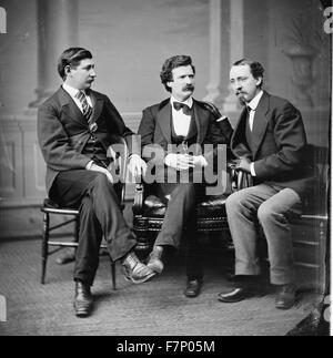 Mark Twain (Samuel L. Clemens) [center] George Alfred Townsend on [his] right, David Gray on [his]left - Stock Photo