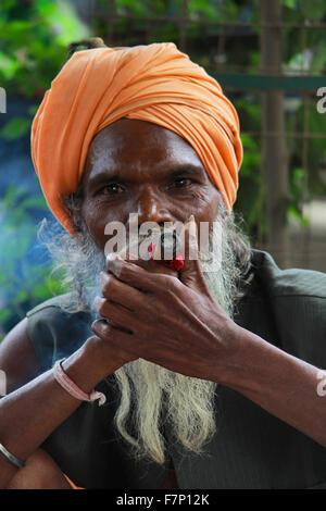 Sadhu smoking chillum Kumbh Mela, Nasik, Maharashtra, India - Stock Photo