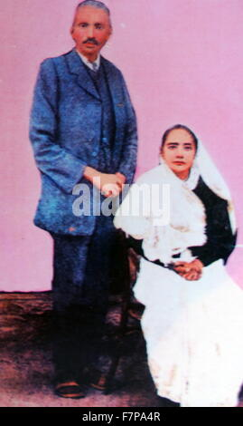 Mohandas Karamchand Gandhi with his wife Kasturba in 1914. Gandhi (1869 – 1948), was the preeminent leader of the - Stock Photo