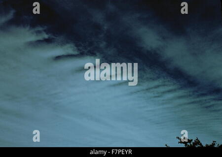 Photograph of Altocumulus cloud, a middle-altitude cloud genus that belongs to the stratocumuliform physical category. - Stock Photo
